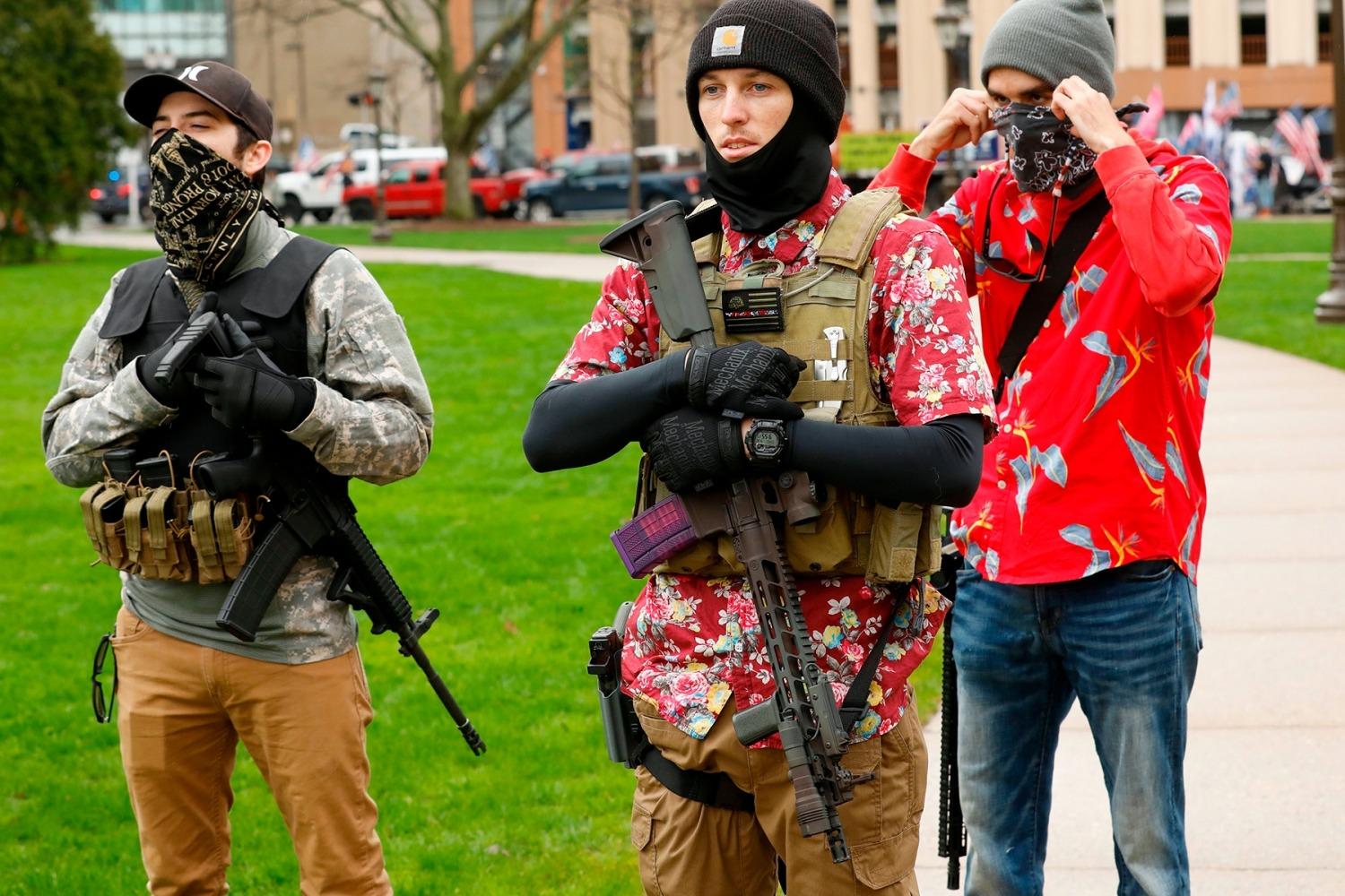 "Armed protesters provide security as demonstrators take part in an ""American Patriot Rally,"" organized on April 30, 2020, by Michigan United for Liberty on the steps of the Michigan State Capitol in Lansing, demanding the reopening of businesses. - Michigan's stay-at-home order declared by Democratic Governor Gretchen Whitmer is set to expire after May 15. (Photo by JEFF KOWALSKY / AFP) (Photo by JEFF KOWALSKY/AFP via Getty Images)"