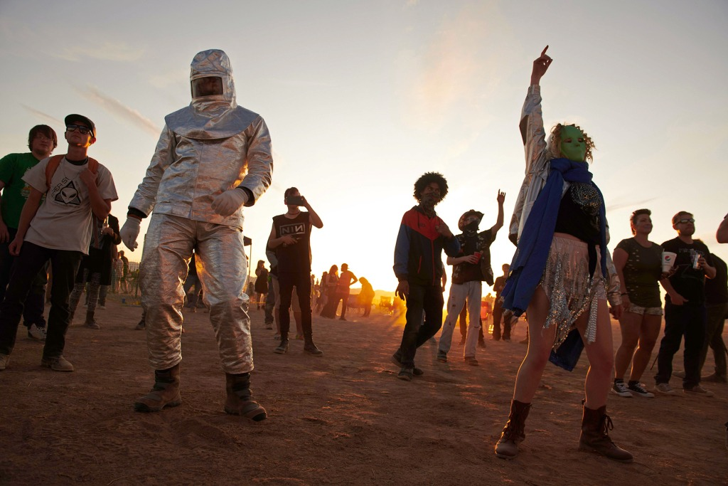 """Attendees dance to music during Alienstock festival on the """"Extraterrestrial Highway in Rachel, Nevada on September. 20, 2019. - A joke Facebook event named """"Storm Area 51, They Can't Stop All of Us,"""" was created in June 2019. As of September 13, more than 2 million people had signed up for the event and a 1.5 million more had marked themselves as """"interested."""" Multiple alien related events are now set to take place over the weekend of September 20, 2019 along state Route 375 also known as the """"Extraterrestrial Highway."""" (Photo by Bridget BENNETT / AFP) (Photo credit should read BRIDGET BENNETT/AFP via Getty Images)"""
