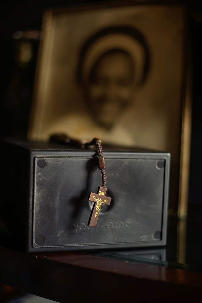 A box holds the remains of Lionel Ferdinand, who died at home of COVID-19.