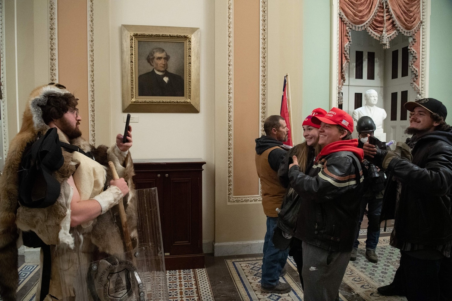Supporters of US President Donald Trump protest in the US Capitol Rotunda on January 6, 2021, in Washington, DC. - Demonstrators breeched security and entered the Capitol as Congress debated the a 2020 presidential election Electoral Vote Certification. (Photo by SAUL LOEB / AFP) (Photo by SAUL LOEB/AFP via Getty Images)
