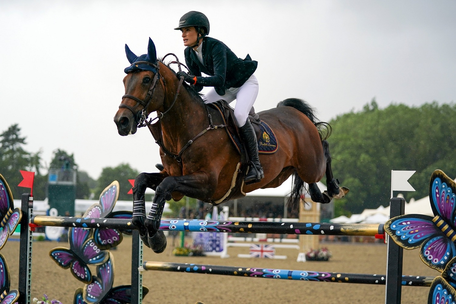 Royal Windsor Horse Show 2021. Jessica Springsteen riding Don Juan van de Donkhoeve competes in the Rolex Grand Prix at the Royal Windsor Horse Show, Windsor. Picture date: Sunday July 4, 2021. Photo credit should read: Steve Parsons/PA Wire URN:60747593 (Press Association via AP Images)